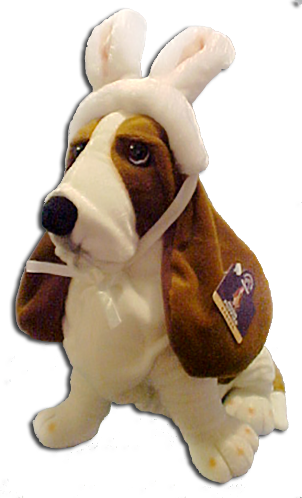 The Hushpuppies Logo Basset Hound puppy dressed in Bunny Ears and carrying Easter Eggs!